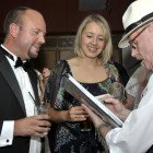Midlands Travel Trade Ball at the Belfrey, Mark Ellis of Travel Management Group and Claire Macklin of BMI Regional with John Roberts, Characaturist