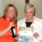 The second winner of a place on a Cyplon Holidays educational and a bottle of wine Gaynor Bates, Co Op Heywood receives her prize from Jayne Scott, Cyplon Holidays
