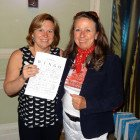 The Winner of 2 nights stay at either So White or So Nice apartments Vikki Bennett Co Operative PTA (left), receives her prize from Sandra Bruce So Nice/ So White/ Porto Carras